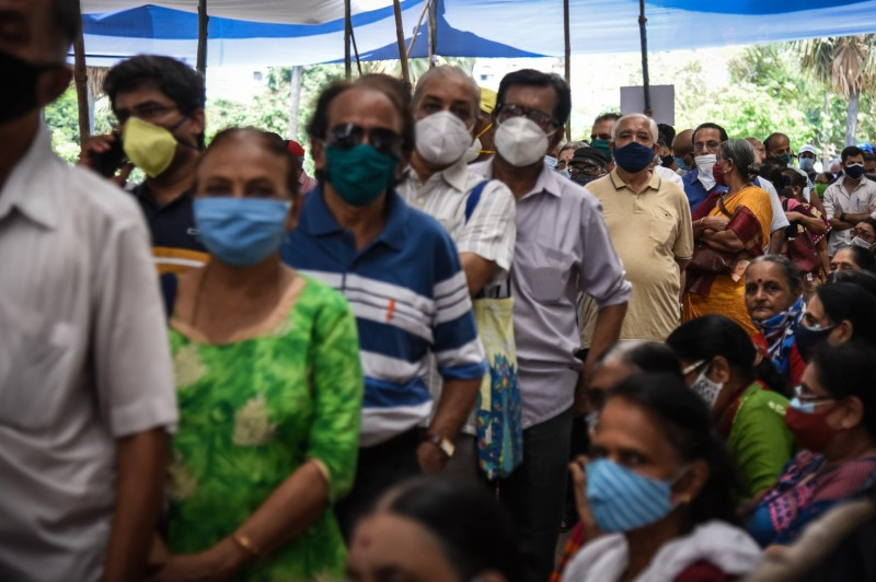 People line up to receive COVID-19 vaccines in India.