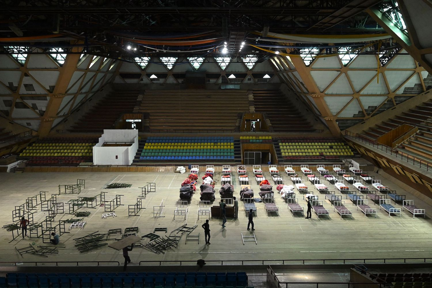 Workers prepare to convert an indoor stadium into a coronavirus center in Srinagar, Indian-administered Kashmir, on April 27.