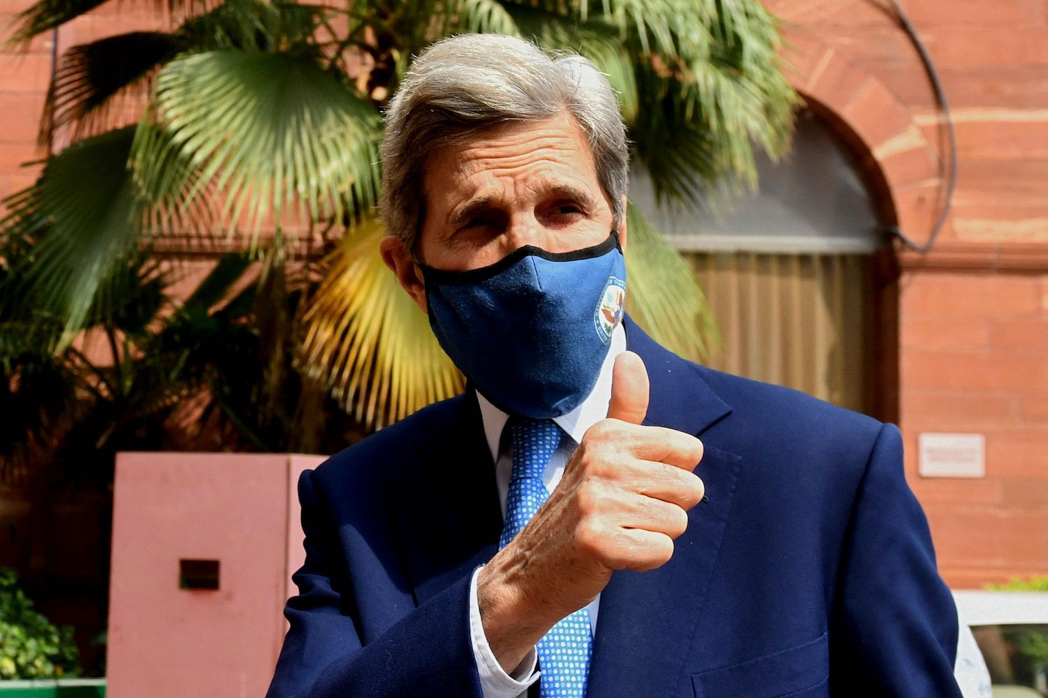 U.S. climate envoy John Kerry gesture as he arrives at the Ministry of Finance for a meeting with Indian Finance Minister Nirmala Sitharaman, in New Delhi on April 6.