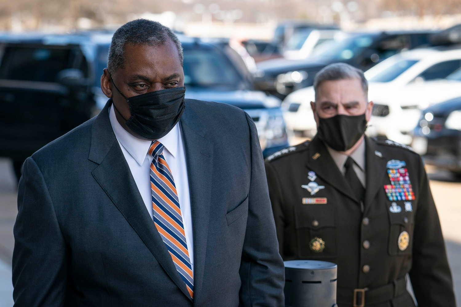 Mark Milley, chairman of the Joint Chiefs of Staff, escorts incoming Secretary of Defense Lloyd Austin to the Pentagon on Austin's first day in his new role in Arlington, Virginia, on Jan. 22.