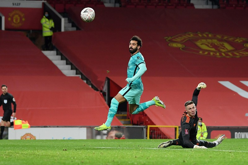 Mohamed Salah of Liverpool scores a goal against Manchester United.