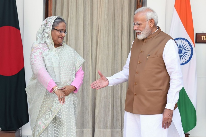 Indian Prime Minister Narendra Modi shakes hands with Bangladeshi Prime Minister Sheikh Hasina prior to a meeting in New Delhi on October 5, 2019.