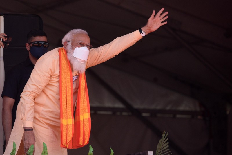 Indian Prime Minister Narendra Modi gestures during a campaign rally ahead of West Bengal Assembly elections in Jaynagar, near Kolkata, India, on April 1.