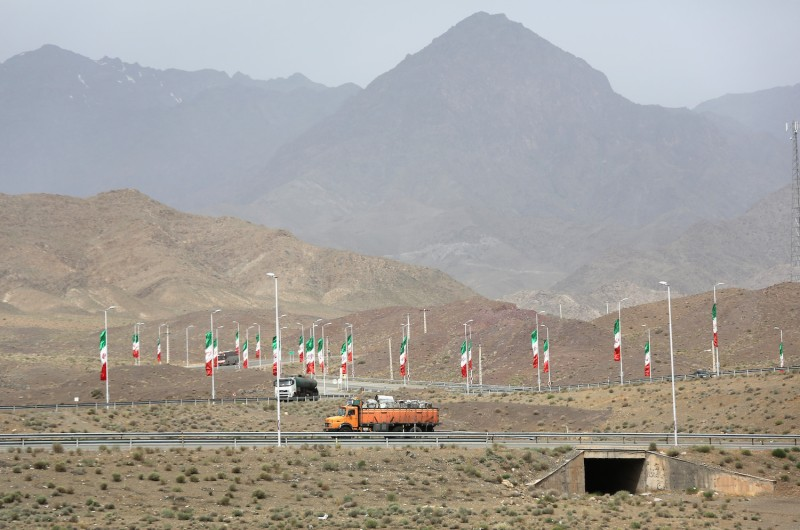 Iranian flags fly along the highway.