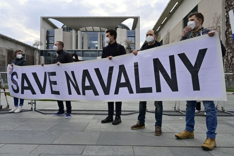 Demonstrators in Berlin display banners in support of Kremlin critic Alexei Navalny
