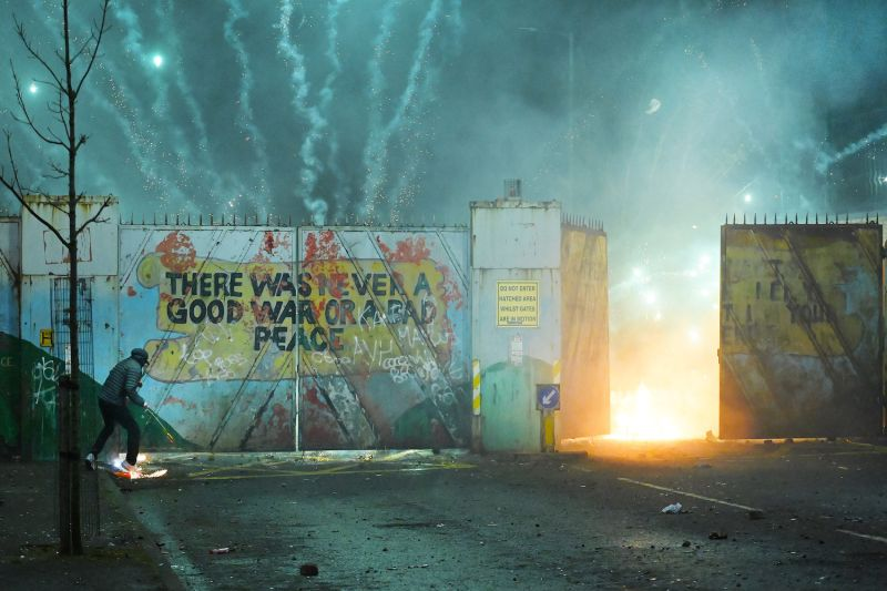 Nationalists and Loyalists riot at the Peace Wall gates which divide the two communities on April 7 in Belfast, Northern Ireland.
