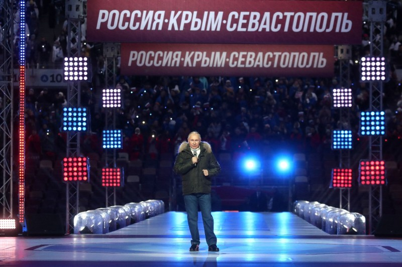 Russian President Vladimir Putin speaks during a rally marking the seventh anniversary of Russia's annexation of Crimea at the Luzhniki Stadium in Moscow on March 18.
