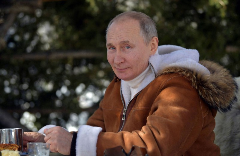 Russian President Vladimir Putin poses for a photo while on vacation in Siberia on March 21.