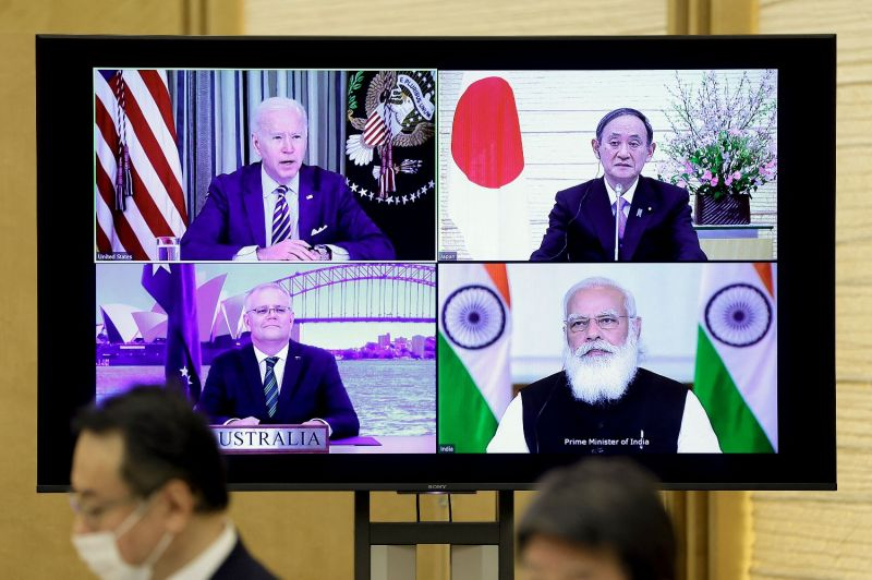 A monitor displays a virtual meeting between U.S. President Joe Biden, Japanese Prime Minister Yoshihide Suga, Indian Prime Minister Narendra Modi, and Australian Prime Minister Scott Morrison at Suga's official residence in Tokyo on March 12.