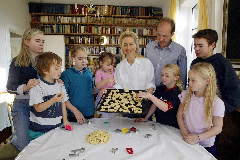 Von der Leyen, then social affairs minister of Lower Saxony, with her seven children and her husband, Heiko von der Leyen, after baking cookies in Hanover, Germany, on Nov. 11, 2003.