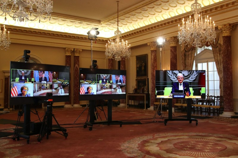 U.N. General Assembly President Volkan Bozkir is seen on a screen at right as U.S. Secretary of State Antony Blinken (out of frame) holds a virtual meeting with him via videoconference from the State Department in Washington, D.C., on March 29.