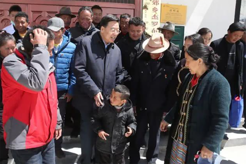 Wu Yingjie, the TAR party secretary, meets villagers in front of the village administration office at Gyalaphug