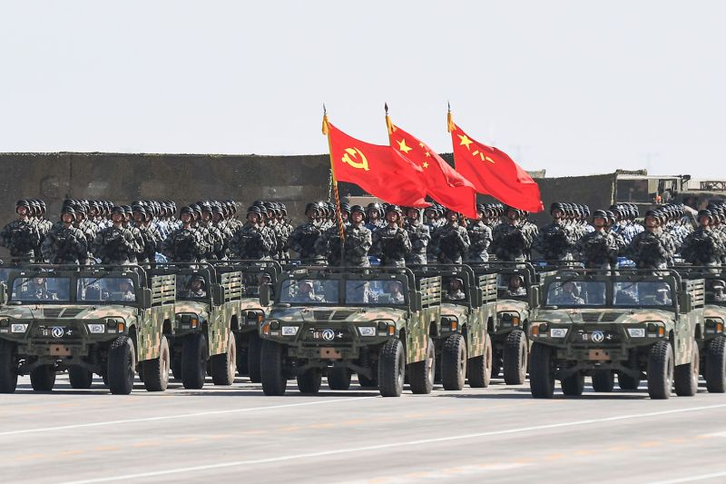 Chinese soldiers carry flags