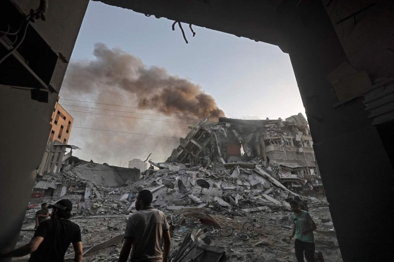 A tower collapsed after being hit by Israeli air strikes in Gaza city.