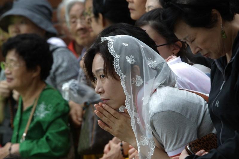 Korean Catholics attend a mass.