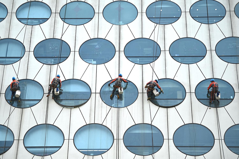 Workers clean the windows in Beijing