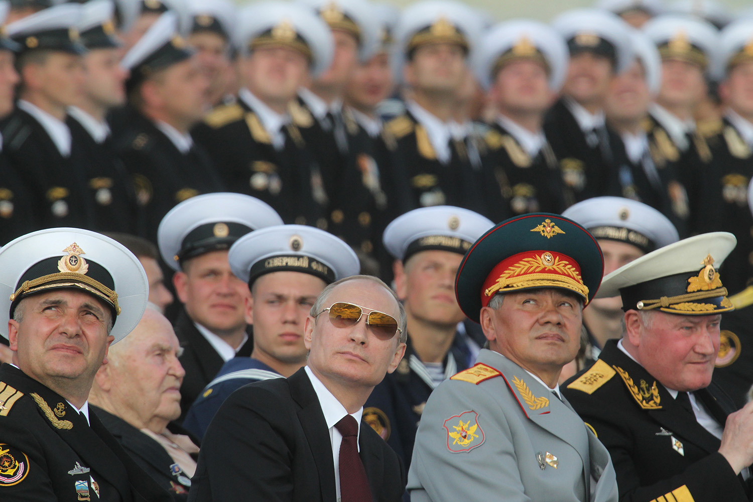 Russian President Vladimir Putin watches the Navy Day military parade