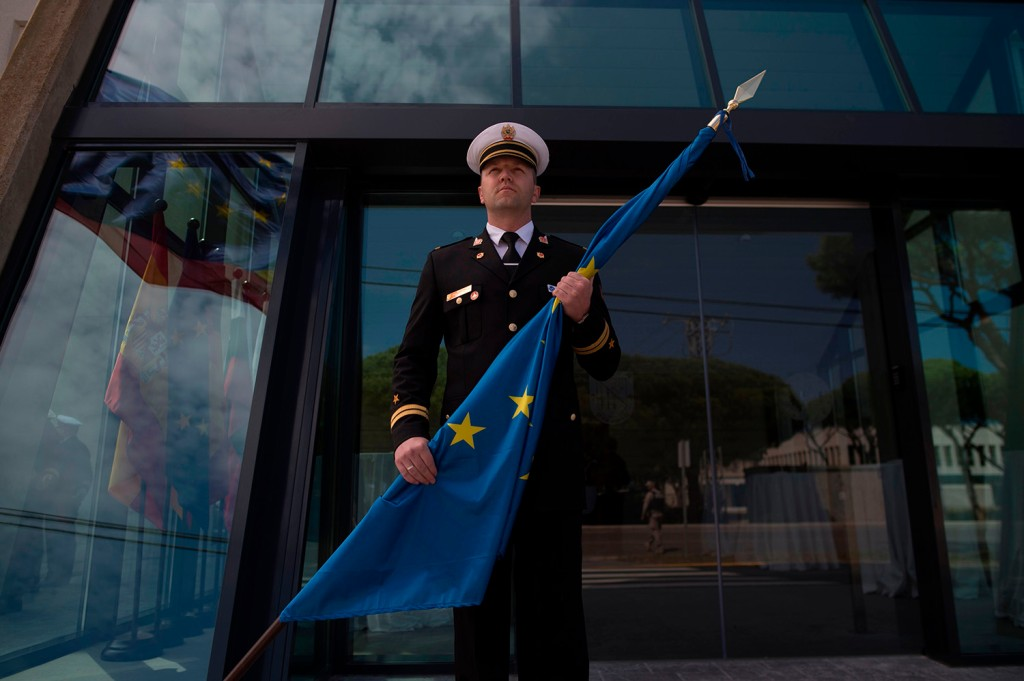 A soldier holds a European Union flag