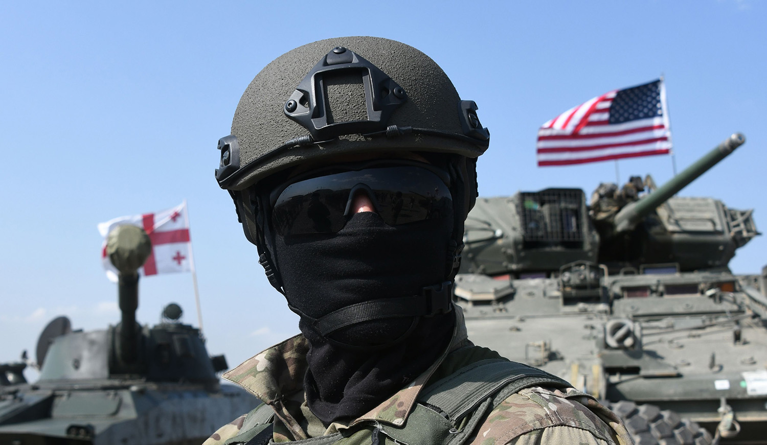 A Georgian serviceman attends the closing ceremony of joint military exercises with NATO forces
