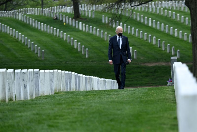 U.S. President Joe Biden walks through Arlington National Cemetery.