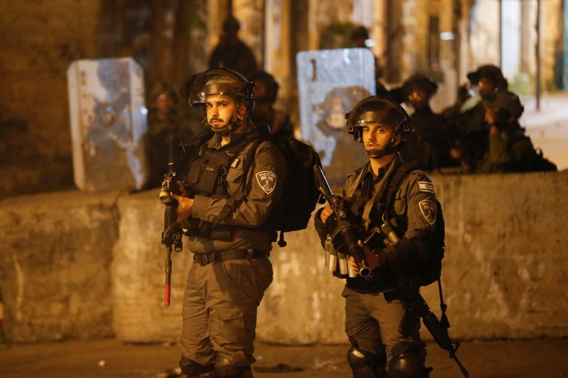 Israeli soldiers looks on during clashes with Palestinian youth in the city center of the occupied West Bank town of Hebron on April 24, 2021.