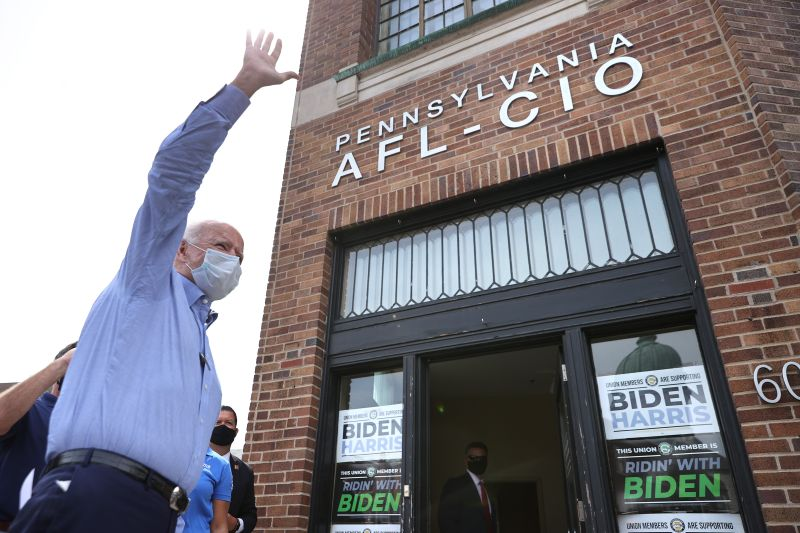 Joe Biden waves to supporters before meeting with local labor leaders ahead at the union's state headquarters on Sept. 7, 2020 in Harrisburg, Pennsylvania.