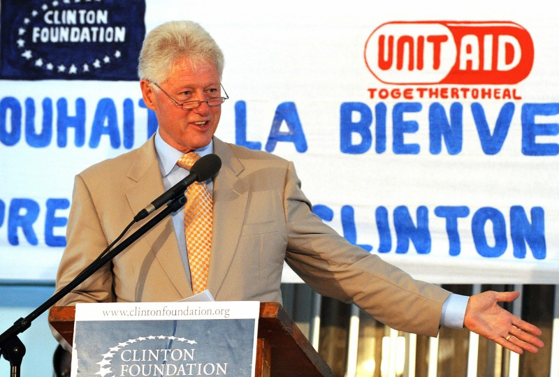 Former U.S. President Bill Clinton speaks at a mobile treatment center.
