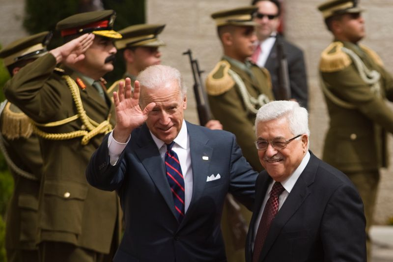 Joe Biden waves alongside Palestinian President Mahmoud Abbas prior to their meeting on March 10, 2010 in Ramallah, West Bank.