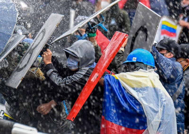 Demonstrators clash with riot police during a protest against President Ivan Duque's government at the Bolivar square in Bogota on May 5.