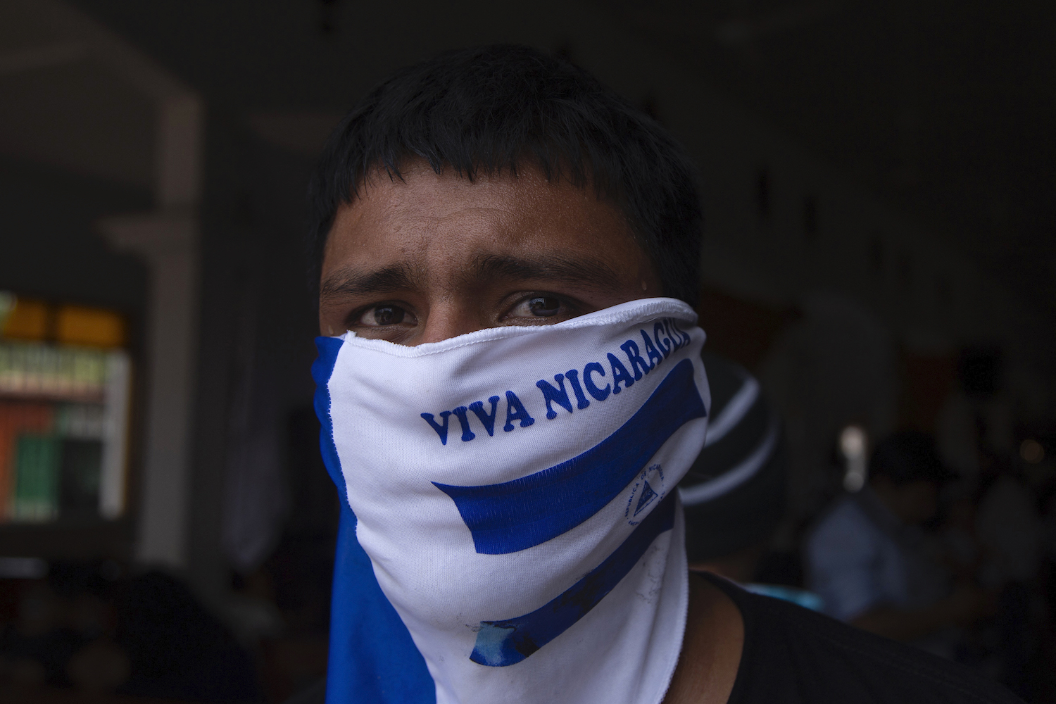 A man attends a mass to commemorate the third anniversary of the beginning of the protests against the government of President Daniel Ortega, at the Church of San Miguel in Masaya, on April 18.