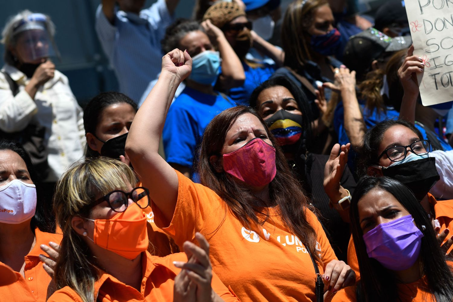 Venezuelan opposition activists take part in a demonstration to demand greater rights for women outside the United Nations Development Programme building in Caracas, on March 8.