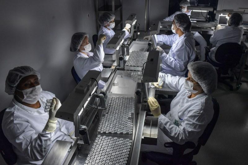 Employees work on the production line of CoronaVac, Sinovac Biotech's vaccine against COVID-19 coronavirus at the Butantan biomedical production center, in Sao Paulo, Brazil, on Jan. 14.