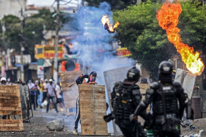 Demonstrators clash with riot police during a protest in Cali, Colombia, on April 29.