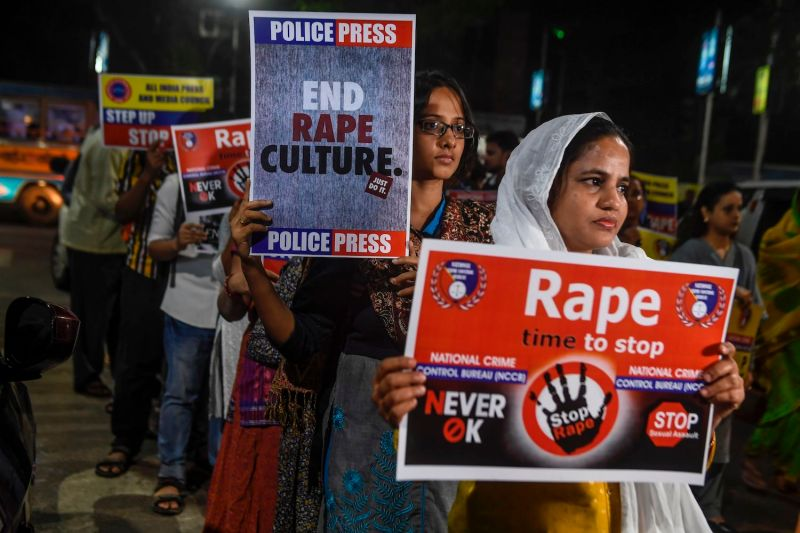 Demonstrators hold placards to protest sexual assaults on women in Kolkata, India, on Dec. 4, 2019.