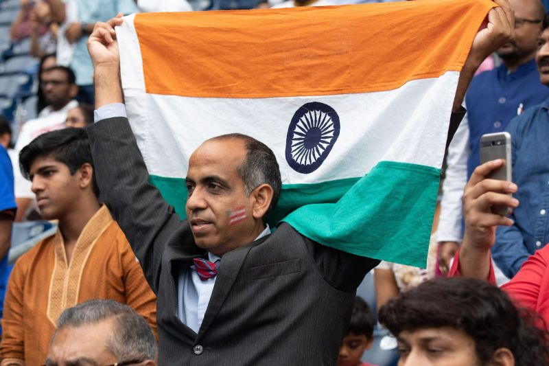 A man holds up an Indian flag at a rally featuring. U.S. President Donald Trump and Indian Prime Minister Narendra Modi at NRG Stadium in Houston on Sept. 22, 2019.