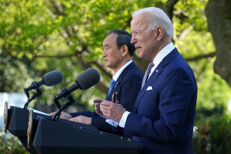 U.S. President Joe Biden and Japanese Prime Minister Yoshihide Suga take part in a joint press conference in the Rose Garden of the White House in Washington on April 16.
