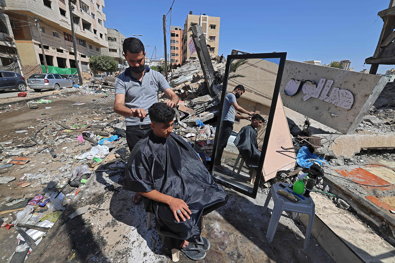 A Palestinian barber amid rubble