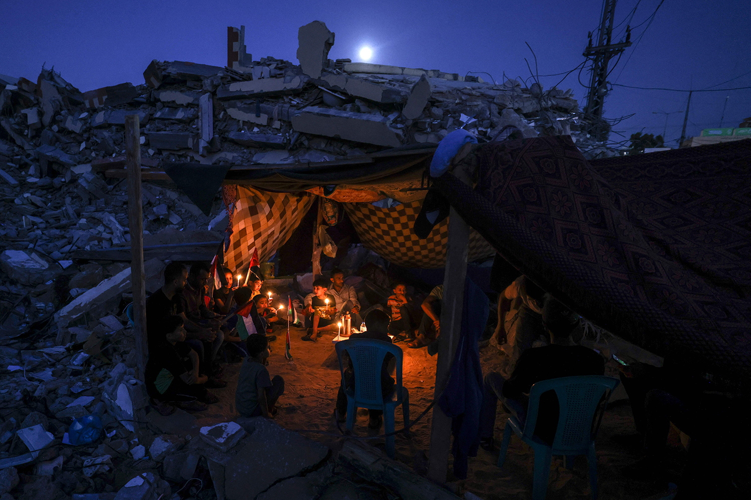 Palestinians sit in a tent