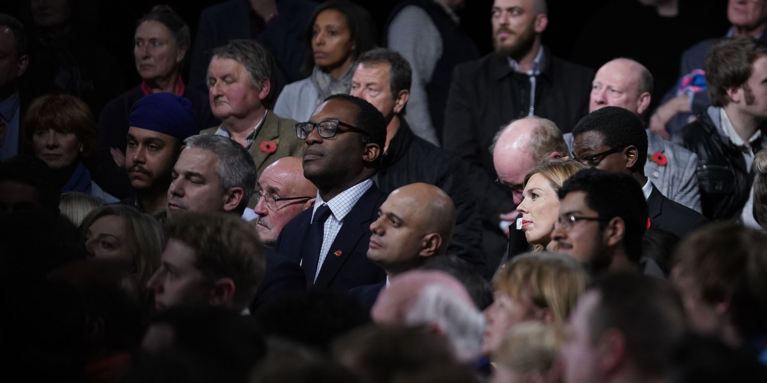 Kwarteng listens among the crowd as Home Secretary Priti Patel talks onstage at the launch of the Conservative Party's General Election campaign in Birmingham, England, on Nov. 6, 2019.
