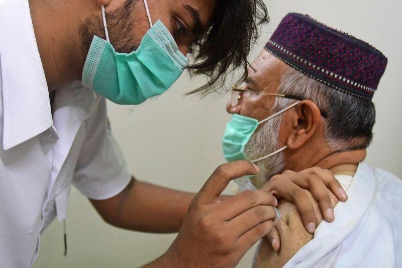 A man receives the coronavirus vaccine in Pakistan.
