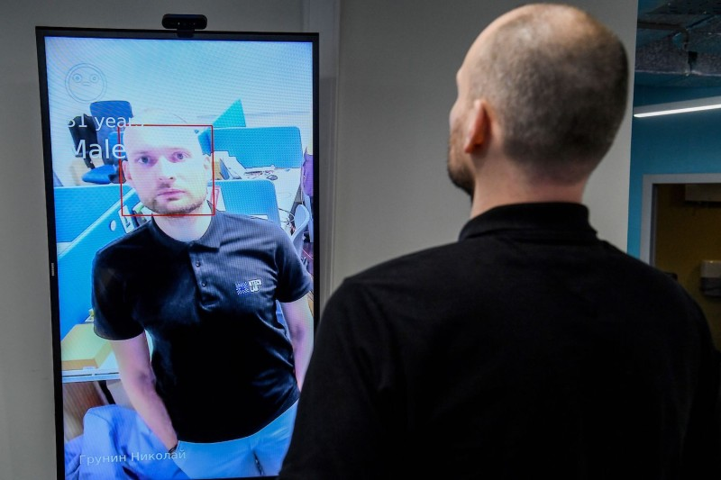Nikolai Grunin, an employee at the Russian technology company NtechLab, which won the city of Moscow's tender to supply its facial recognition algorithm, demonstrates the technology during an interview with AFP on Feb. 5, 2020.