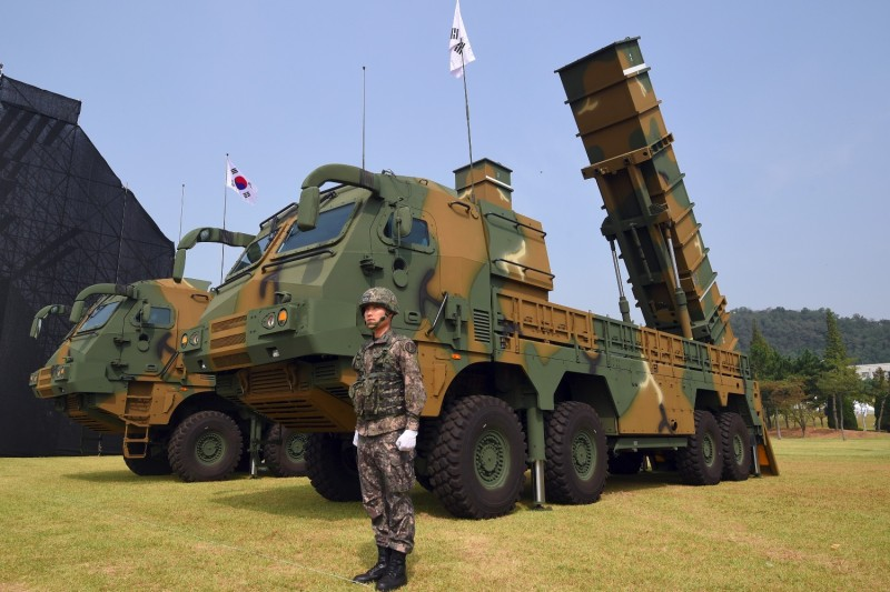 A South Korean soldier stands by a Hyunmoo-2 ballistic missile system