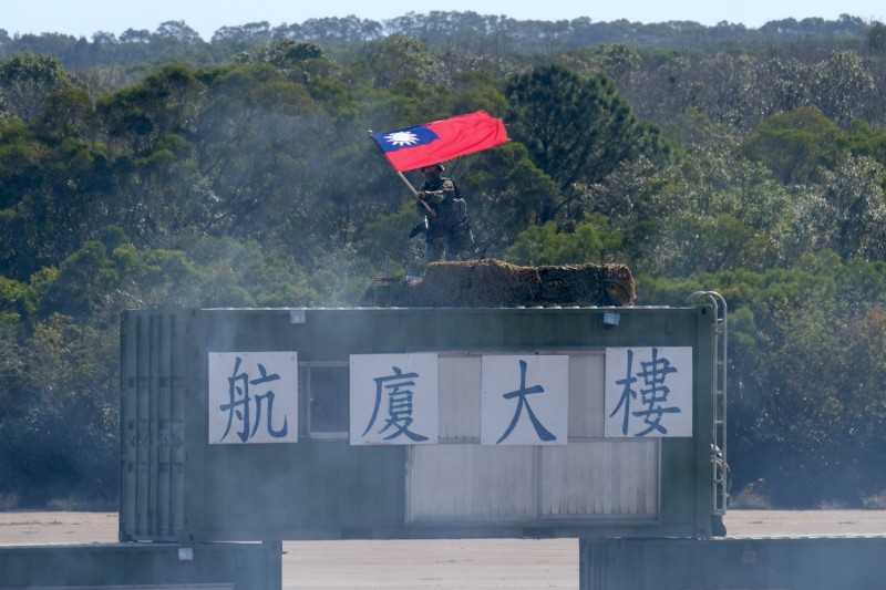A Taiwanese soldier waves a flag.