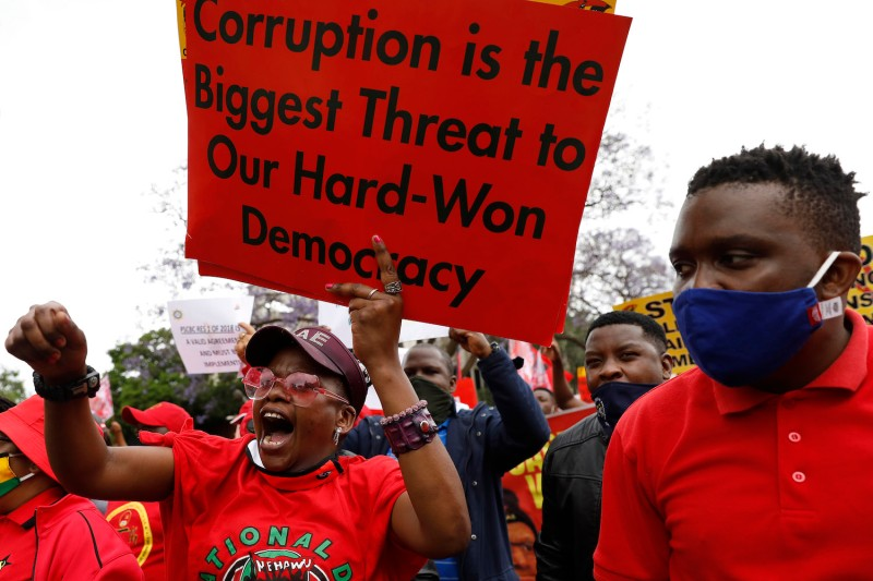 Members of Congress of South African Trade Unions march to the National Treasury during their strike against corruption and unemployment in Pretoria on Oct. 7, 2020.