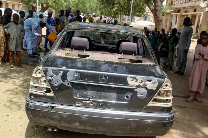 The wreckage of a car hit by a Boko Haram attack is seen in Maiduguri, Nigeria, on Feb. 24.