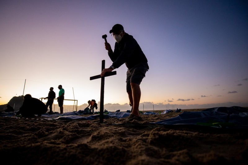 A man prepares an event to pay homage to the  400,000 Brazilians who have died from COVID-19 and to protest against the government response in Rio de Janeiro on April 30.