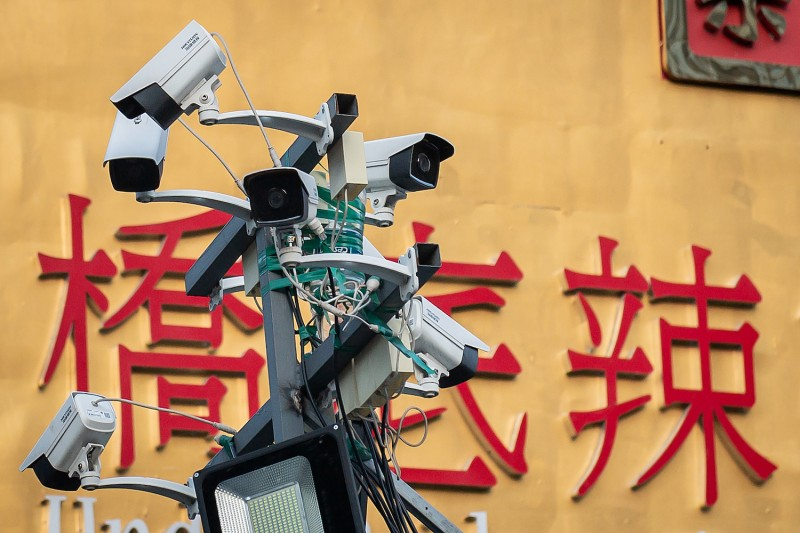 Security cameras are seen at the entrance of a bar and restaurant area in Beijing on April 20, 2020.
