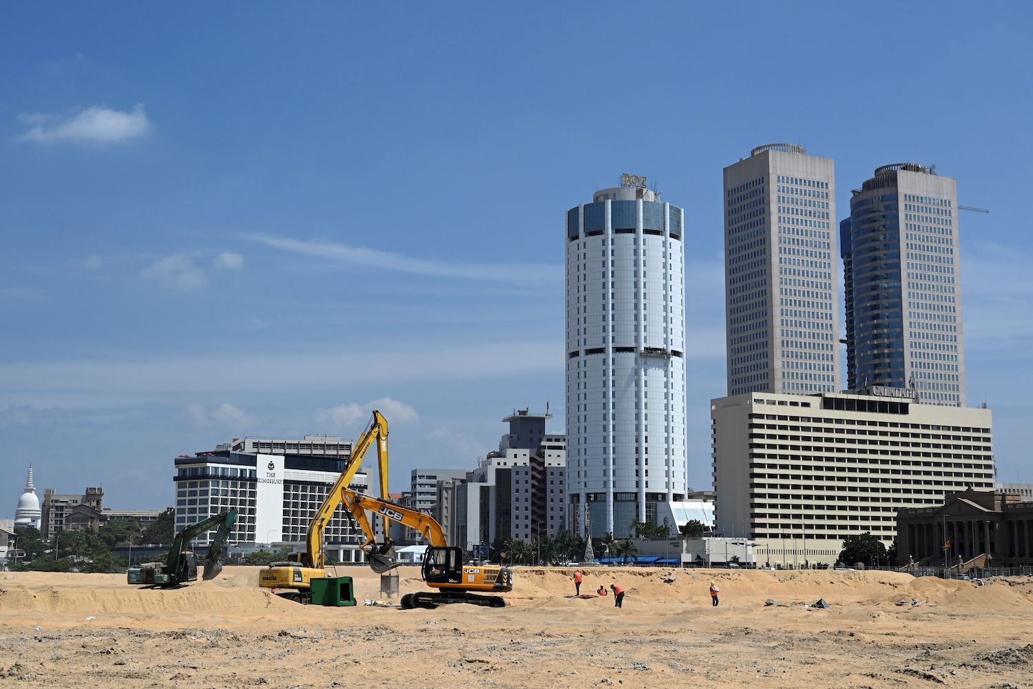 Excavators move soil at a construction site on reclaimed land, part of the Chinese-funded Port City project in Colombo, Sri Lanka, on Feb. 24, 2020.