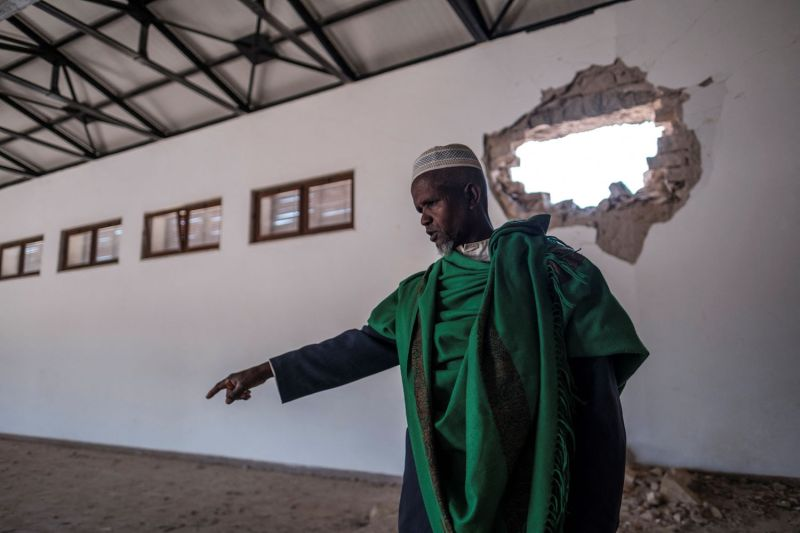 An Ethiopian Muslim stands in a damaged building at the al-Nejashi Mosque, one of the oldest in Africa and allegedly damaged by Eritrean shelling, in Negash, Ethiopia on March 1.