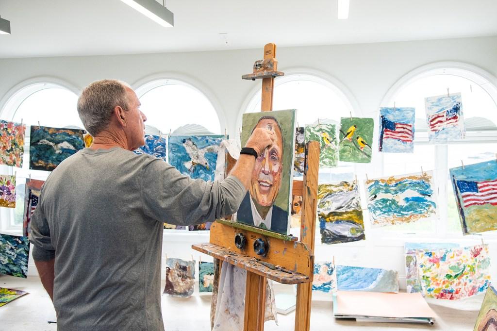 Former U.S. President George W. Bush paints.